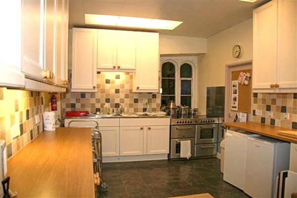 Fully fitted Kitchen with cooker, microwave, urn, fridge and freezer - plus all tableware.