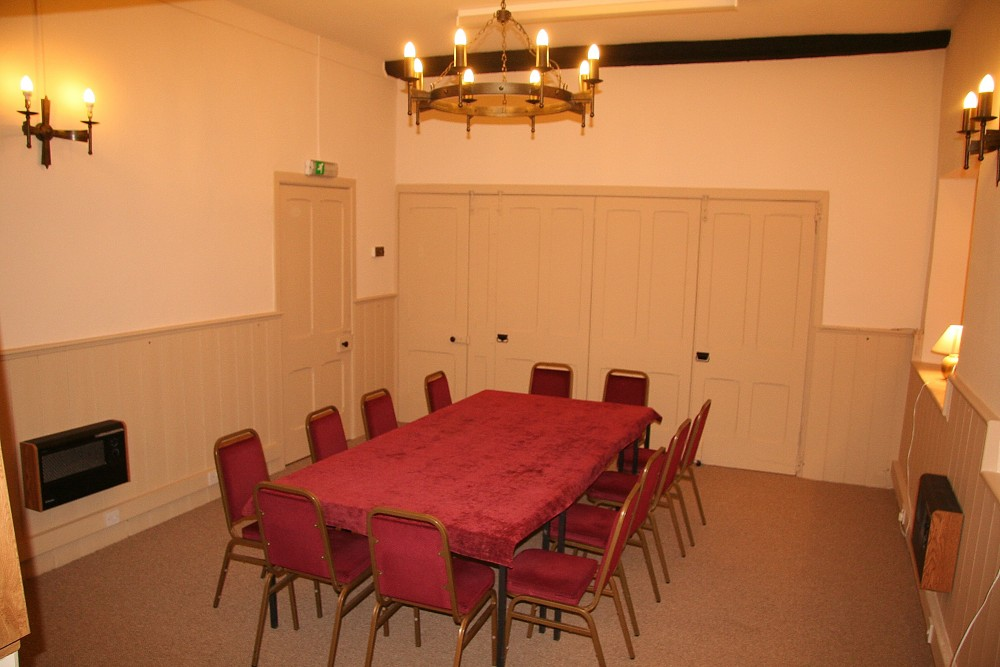 Ante room screened off to create smaller Meeting Room.   Table is 4 movable 2'x4' tables.